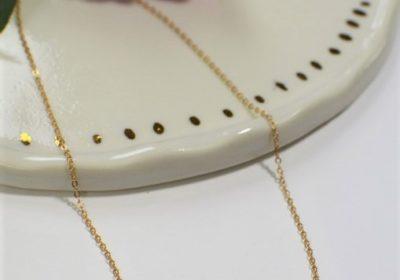 Tour de cou barre doré à l'or 18 carats
